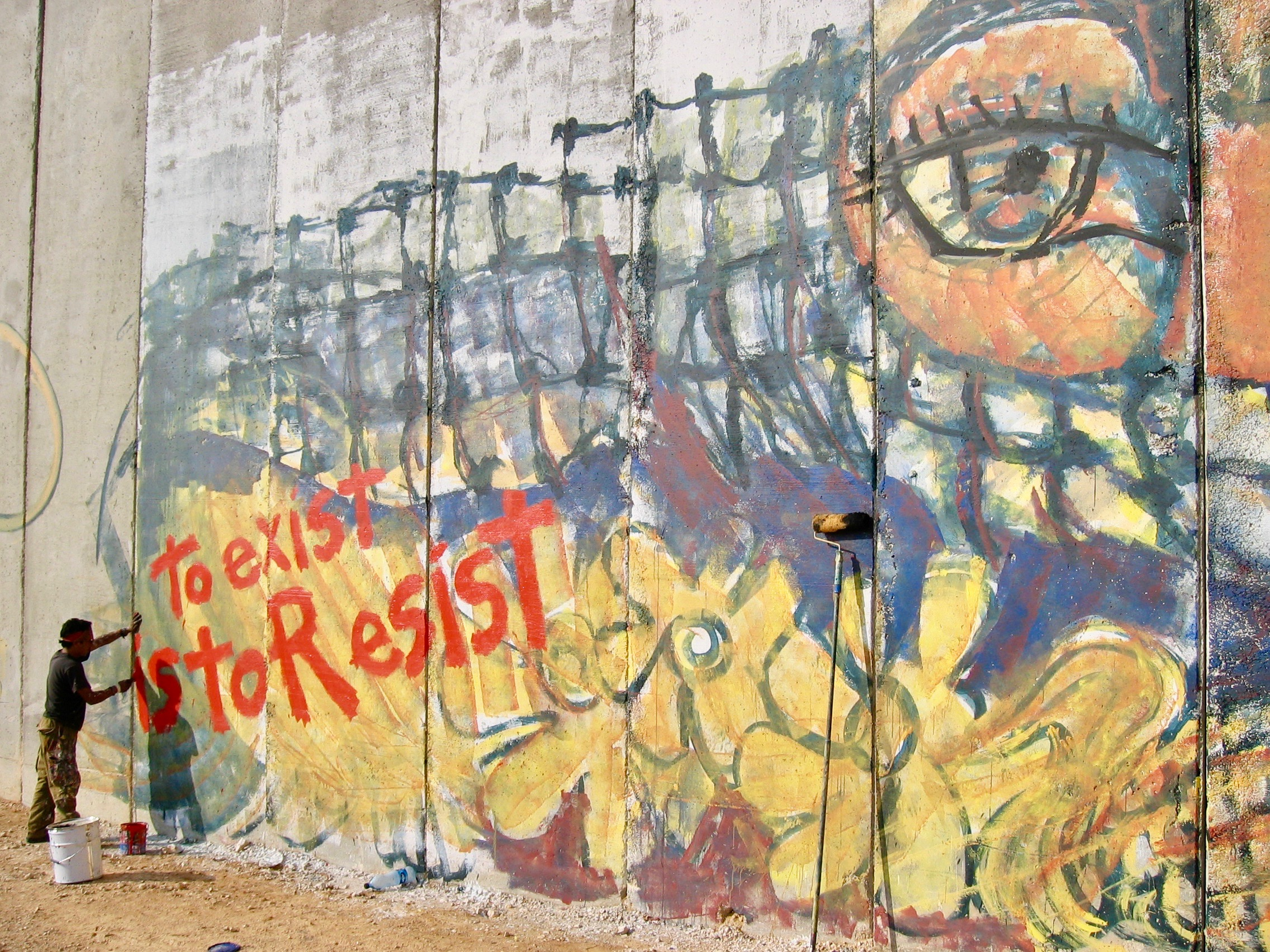 """To Exist is to Resist"" mural on the Israeli Apartheid Wall by Gustavo Chávez Pavón. Photo reproduced with permission of the artist."